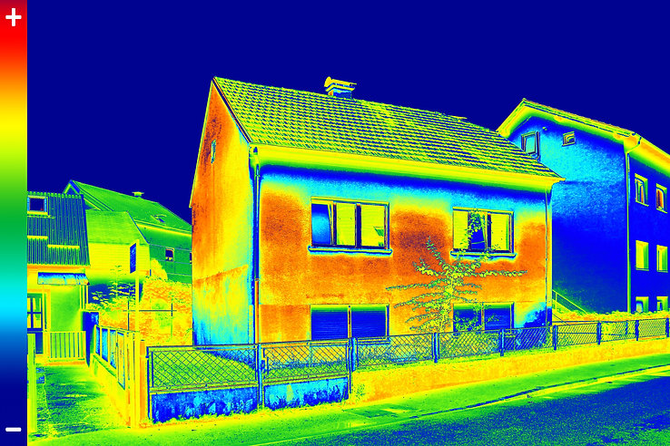 Infrared thermovision image showing lack of thermal insulation on House.jpg