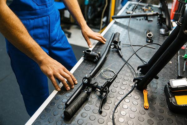 Bicycle assembly, man installs handlebar