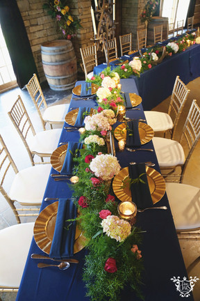 Dining Tables: Tan Majestic Head Table: Navy Majestic Napkins: Navy Cotton Chargers: Gold Floral: TK Wedding & Design Cake: Ms. Laura's Cakes Cake Table Linen: Antique Gold Glitz and Glimmer Photo Credit: Sarah Baker Photos | sarahbakerphotos.shootproof.com