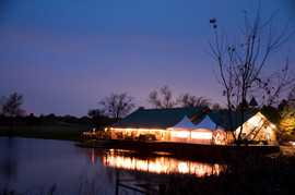 Five Oaks Lodge at Night with Tents on Deck