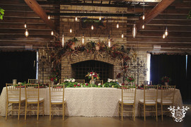 Lighting (hanging bulbs): Infinity Lighting and Sound Floral: The French Bouquet Table Linen: Valentina Lace in Champagne Photo Credit: Sarah Baker Photos