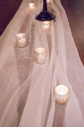 White voile table runner with mercury glass votives Photo Credit: Ace Cuervo Photography