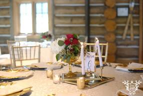Dining Table Linen: Somerset White Napkins: Ivory Floral: TK Wedding & Design Chairs: Gold Chiavari Cake: Ms. Laura's Cakes Cake Table Linen: White Polyester Photo Credit: Sarah Baker Photos | sarahbakerphotos.shootproof.com