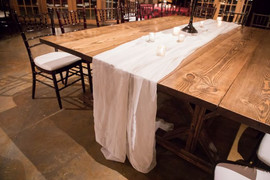 Farm Tables, rented on behalf of the client, with white voile drape Chairs: Mahogany Chiavari Floral: Toni's Flowers and Gifts Photo Credit: Ace Cuervo Photographer