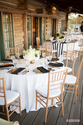 Dining Table Linen: Tone-on-tone White  Napkins: Black  Chargers: Gold Centerpieces: The French Bouquet Photo Credit: Ace Cuervo