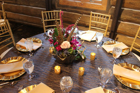 Head Table: Champagne Satin Dining Tables: Metallic Smoke Krinkle Taffeta Cotton Napkins in Rust and Ivory  Chargers in Gold Gold Chiavari Chairs