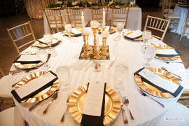 Dining Tables: Imperial Stripe White Napkins: Black Cotton Charger: Gold Scallop Photo Credit: Ace Cuervo Photography