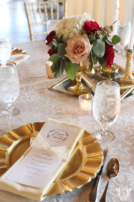 Dining Table Linen: Somerset White Napkins: Ivory Floral: TK Wedding & Design Chairs: Gold Chiavari Cake: Ms. Laura's Cakes Cake Table Linen: White Polyester Photo Credit: Sarah Baker Photos   sarahbakerphotos.shootproof.com