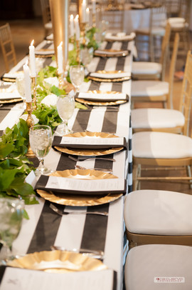 Head Table Linen: Cabana Stripe in Black-White Centerpiece Floral: The French Bouquet Photo Credit: Ace Cuervo