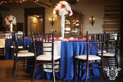Sapphire Blue Majestic Linen with Ivory sequin table runner and raspberry napkins.