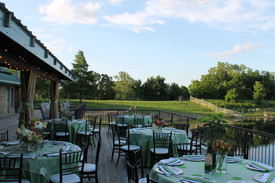 Dining Tables: Lime Green Satin with our Lime Green Dot confetti overlay.  Napkins: White cotton and Lime Green Satin Chairs: Mahogany Chiavari Chargers: Silver