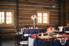 Sapphire blue majestic linen with ivory sequin chair ties and raspberry napkins.