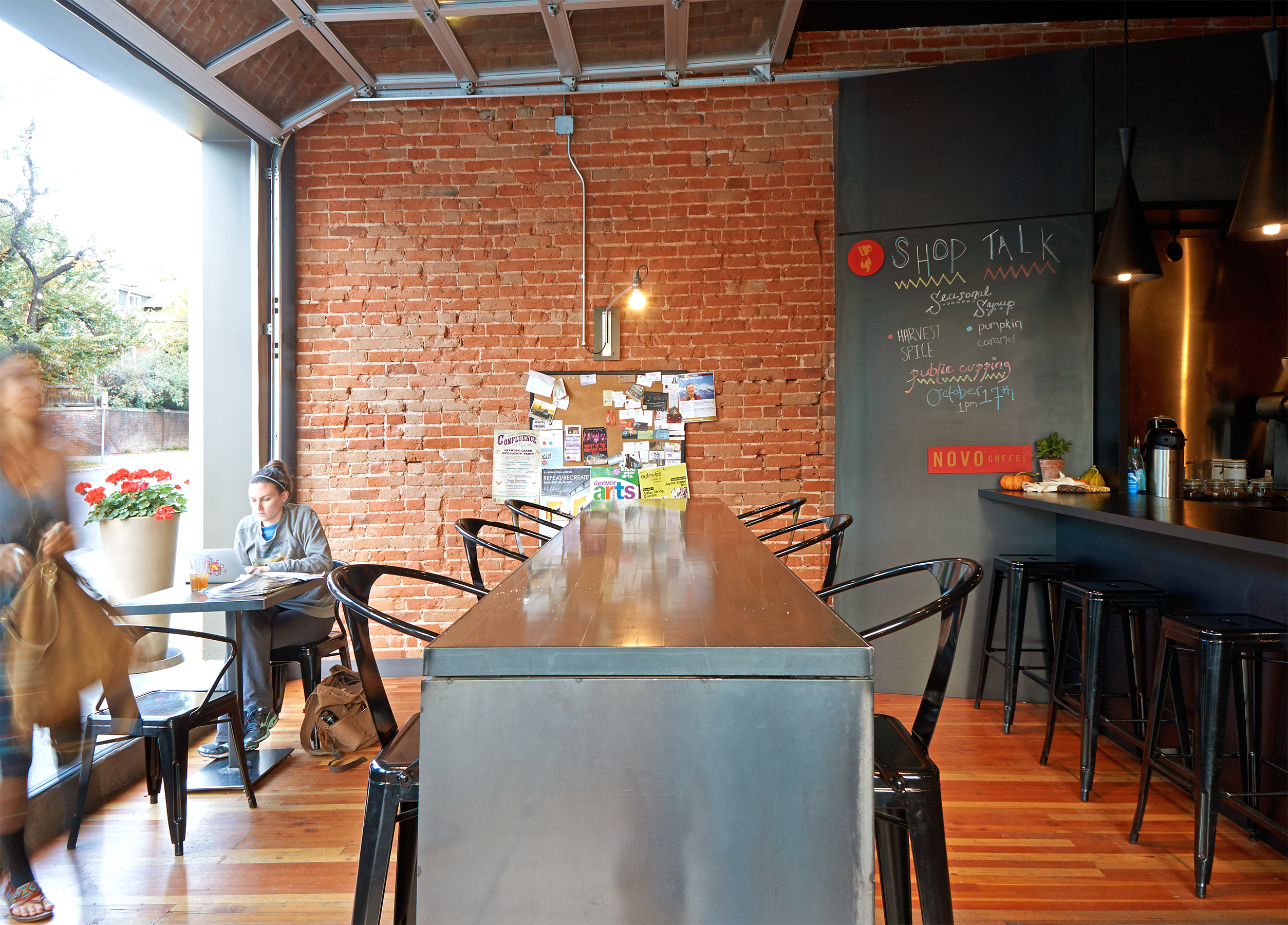 Novo Coffee Shop 6th & Gilpin Garage door community table open studio architecture OSA