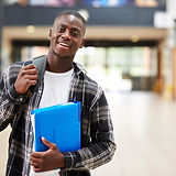 Portrait Of Male Student Standing In Col