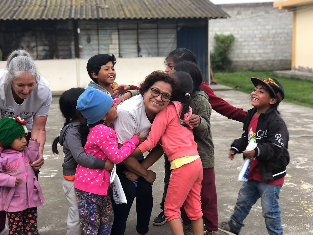 """This year we traveled to Cotacachi, Ecuador.  A beautiful mountain city nestled next a volcano.  We had 3 clinic days and saw 400 patients.  We set up stations at each of our clinics and after each patient was triaged at the door we gave them a form that detailed their treatment plan.  Some came in for just a cleaning while other patients needed full mouth extractions due to cavities and periodontal disease that had run rampant.  We applied fluoride on each of the childrens teeth and did as many fillings as we were able too.  After everyone got their treatment plan paper they were sent to the """"classroom"""" where we had our volutneer Luna giving thorough oral hygiene instructions with models, posters and displays. They then were sent to the hygiene corner where they got their cleaning.  Some would then get an extraction or head over to Dr. Villamar or Dr. Guerra to get fillings done.  Child patients were dismissed with a goodie bag and a toy or stuffed animal. We know how scary it can be to see the dentist and for a lot of these kids it is their first time, we wanted them to leave feeling like it was a positive experience. Our hope is to inspire them to improve their oral  hygiene and keep their beautiful smiles for the rest of their lives.  It was such a rewarding trip and we had an incredible team of volunteers! We look forward to next year!"""