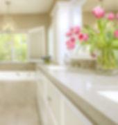bathroom remodel, custom cabinetry, white vanity, quartz top, crystal chandelier, shutters, plumbing fixtures