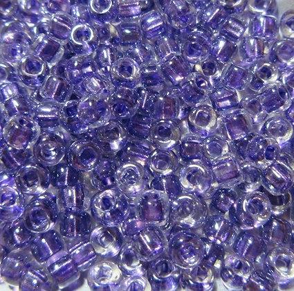 8-710  8/0 Crystal/Purple Lined Luster