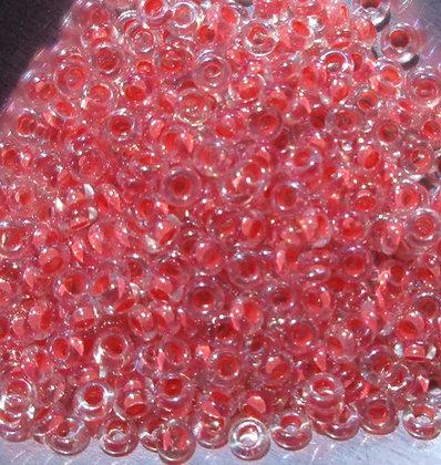 779 - 8/0 Demi Round, Crystal Salmon Lined Rainbow, 8 Grams