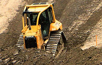 T.H. Miller Excavating Inc. bulldozer grading a lagoon on excavation jobsite