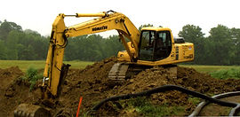 T.H. Miller Excavating Inc. digging trench for tile and pipe work on a construction repair.