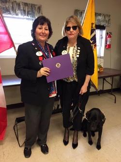 alt text District Governor Debbie DAwson presents New Voices Award