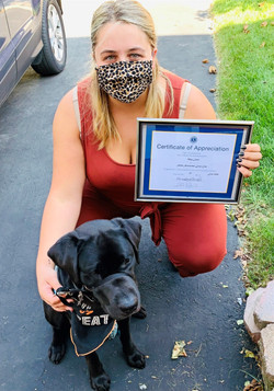 Meg Lavis received an Certificate of Appreciate with foster pup Pepper in 2020