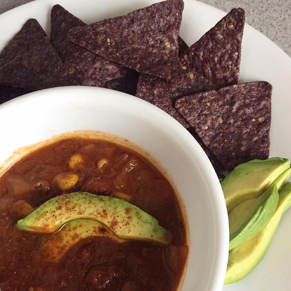 braised beef chili w. fresh avocado + blue corn chips