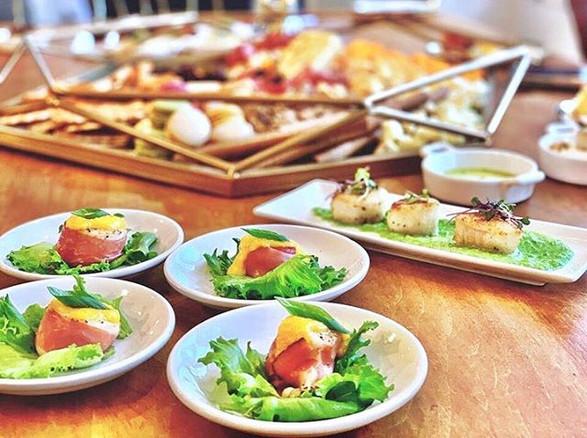 prosciutto wrapped scallops w. mango coulis + cumin dusted sea scallops w. pea puree