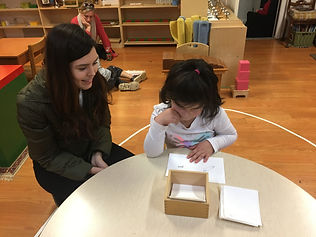 Preschool age child using Montessori mat