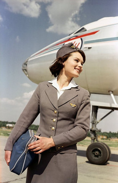 Aeroflot flight attendant after the flight. Photo by Georgy Petrusov, Vnukovo airport, Moscow, USSR, 1960s