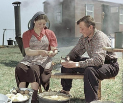 """""""Virgin land workers cook dinner at the field camp"""" Photo by Isaac Tunkel,  Kazakh SSR, 1955"""