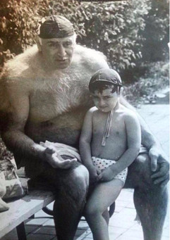 The legendary Soviet Georgian water polo player Pyotr Mshveniradze with his grandson, 1990s