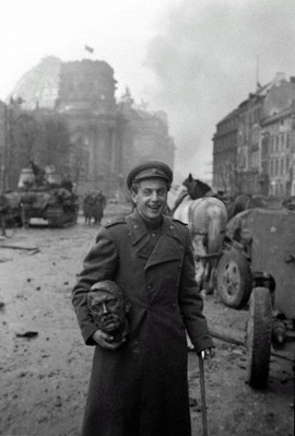 Famous Soviet poet Yevgeny Dolmatovsky poses with the bronze head of Adolf Hitler on the ruined streets of Berlin after the end of hostilities in Europe, Germany,  May 1945. Photo by Evgeni Khaldei
