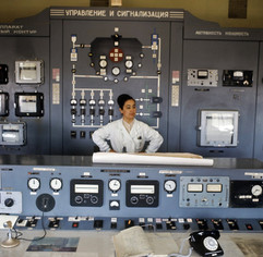 """""""Senior Engineer of the Institute of Nuclear Physics of the Academy of Sciences of the Uzbek SSR Hafiza Yakhyaeva at the control panel of a nuclear reactor"""" photo by N.Klyuchnev, Uzbek SSR, 1975"""