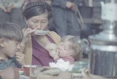 Woman drinking tea. Photo by Vsevolod Tarasevich, Arkhangelsk region, USSR, 1965