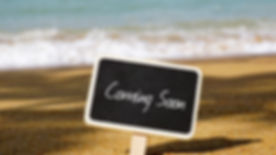 Selective focus of chalk board written with COMING SOON text.jpg