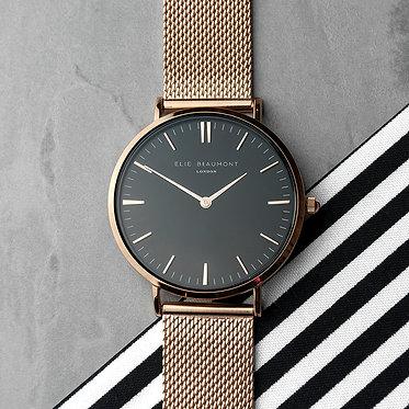 black face rose gold metal watch