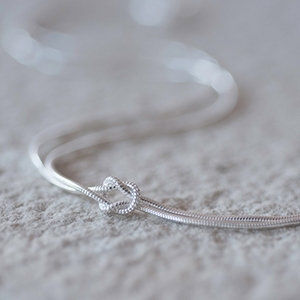 silver tying the knot necklace