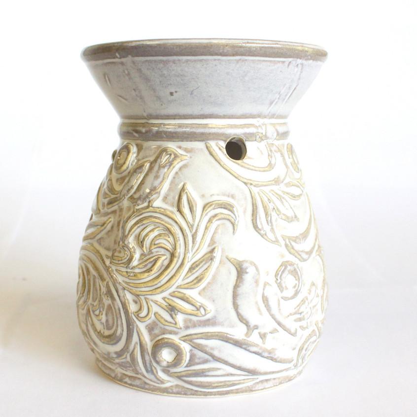 Venetian round scroll design oil burner