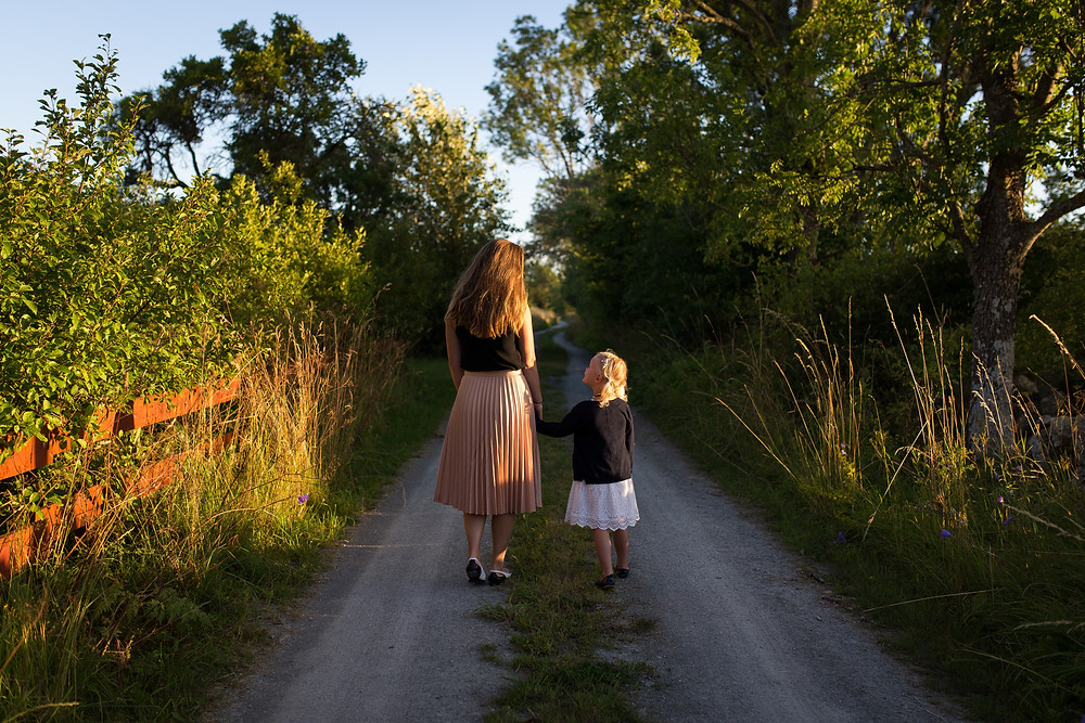 Mother and Child walking down path