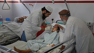 A paramedic attends to ten-year-old Nessar Ahmad, at Emergency Surgical Center for Civilian War Victims in Kabul, Afghanistan, Thursday, Dec. 5, 2019.