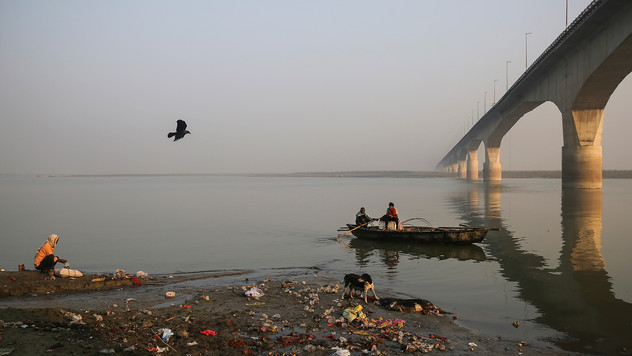 An Indian man, left, fishes as a dog feeds on the carcass of a pig on the banks of the river Ganges in Bhagalpur in the Indian state of Bihar, Wednesday, November 13, 2019. As the Ganges flows across vast swathes of area, its once clean and mineral rich water begins collecting toxic waste from the millions of people who depend on it, becoming one of the most polluted rivers in the world. Several billion liters of sewage, heavy metals, agricultural pesticides, human bodies and animal carcasses are dumped into the Ganges every day.