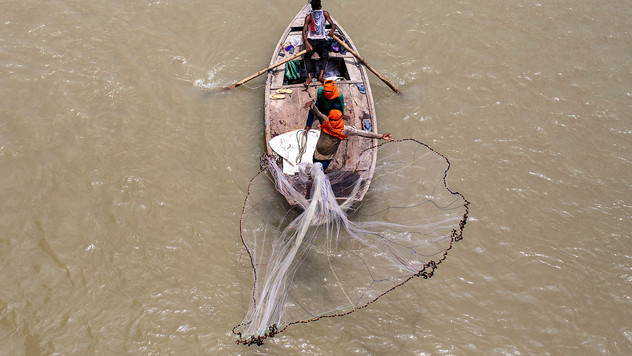 A fisherman casts his net into the river Ganges in Kanpur, an industrial city known for its leather tanneries, in the northern Indian state of Uttar Pradesh, Wednesday, June 24, 2020. Kanpur city produces an estimated 450 million liters of municipal sewage and industrial effluent daily, much of which flowed directly into the Ganges until recently. Today that number is lower, though it's not clear by how much, after a Ganges cleanup project closed some drains and diverted industrial pollution to treatment plants.