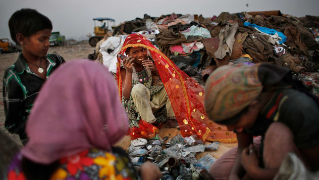 Young Indian waste pickers look for recyclable items at a landfill on the outskirts of New Delhi, India, Oct. 17, 2014 . Rag picking is effectively the primary recycling system in India.