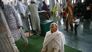 A Kashmiri muslim woman cries while praying at a shrine in Srinagar, the summer capital India-administered Kashmir, 2007.