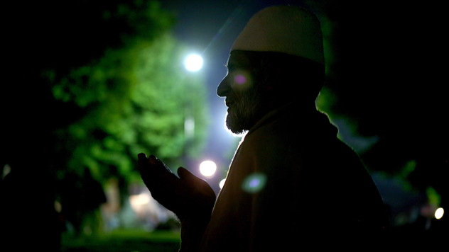 A Kashmiri muslim is silhoutted as he prays in the compound of Hazratbal shrine on Shab-E-Barat, or the night of forgiveness or Day of Atonement, in Srinagar, the summer capital of India-administered Kashmir, India, 2007.