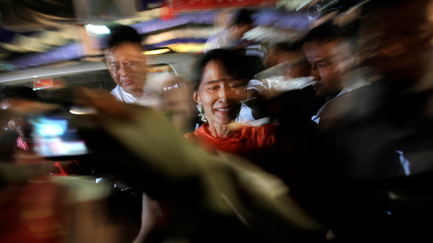 Myanmar's pro-democracy leader Aung San Suu Kyi is greeted by supporters upon her arrival in the village of Wah Thin Kha a day before the country's historical by-elections in 2012.