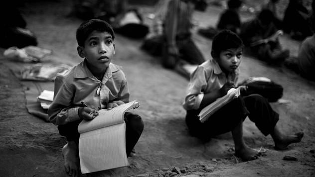 Underprivileged Indian children attend a free school run under a metro bridge in New Delhi, India, Wednesday, Nov. 7, 2012.