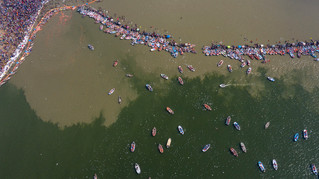 Birds eye view of boats at Sangam, the confluence of rivers Ganges, Yamuna, and mythical Saraswati during Magh Mela, a festival that attracts millions of pilgrims every year, in Prayagraj, in the northern Indian state of Uttar Pradesh.