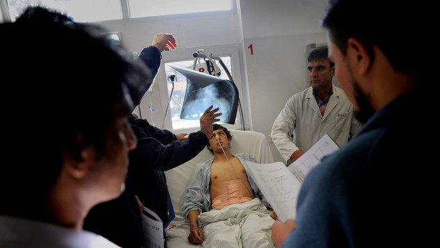 Doctors examine Razi Khan at Emergency Surgical Center for Civilian War Victims in Kabul, Afghanistan, Thursday, Dec. 5, 2019.